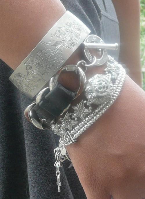 Stacked silver bracelets